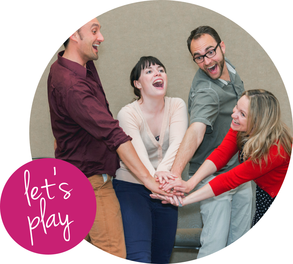 A group of two women and two men stacking hands with excitement. With text bubble in left corner saying let's play.
