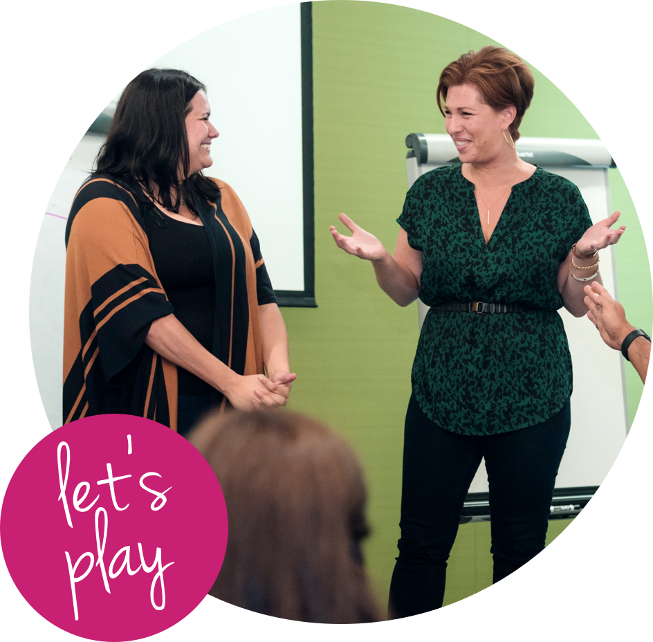 Two women smiling at each other with 'let's play' in a bubble in the left corner