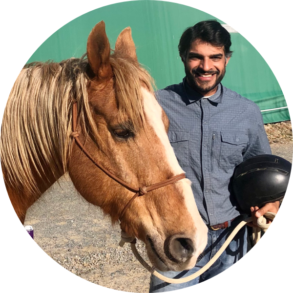 Akshay with a brown horse